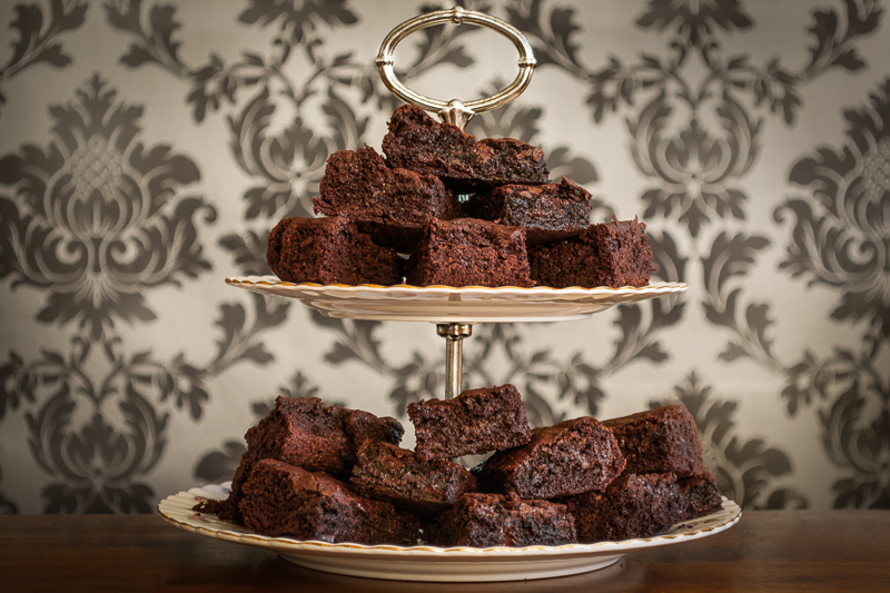 A stack of Gooey Brownies on an Afternoon Tea tiered serving plate