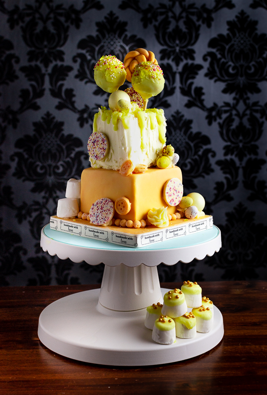 A two tier humpday cake. A mini cake with cake pops, white chocolate jazzies, lindor chocolates and a fondant lollypop.