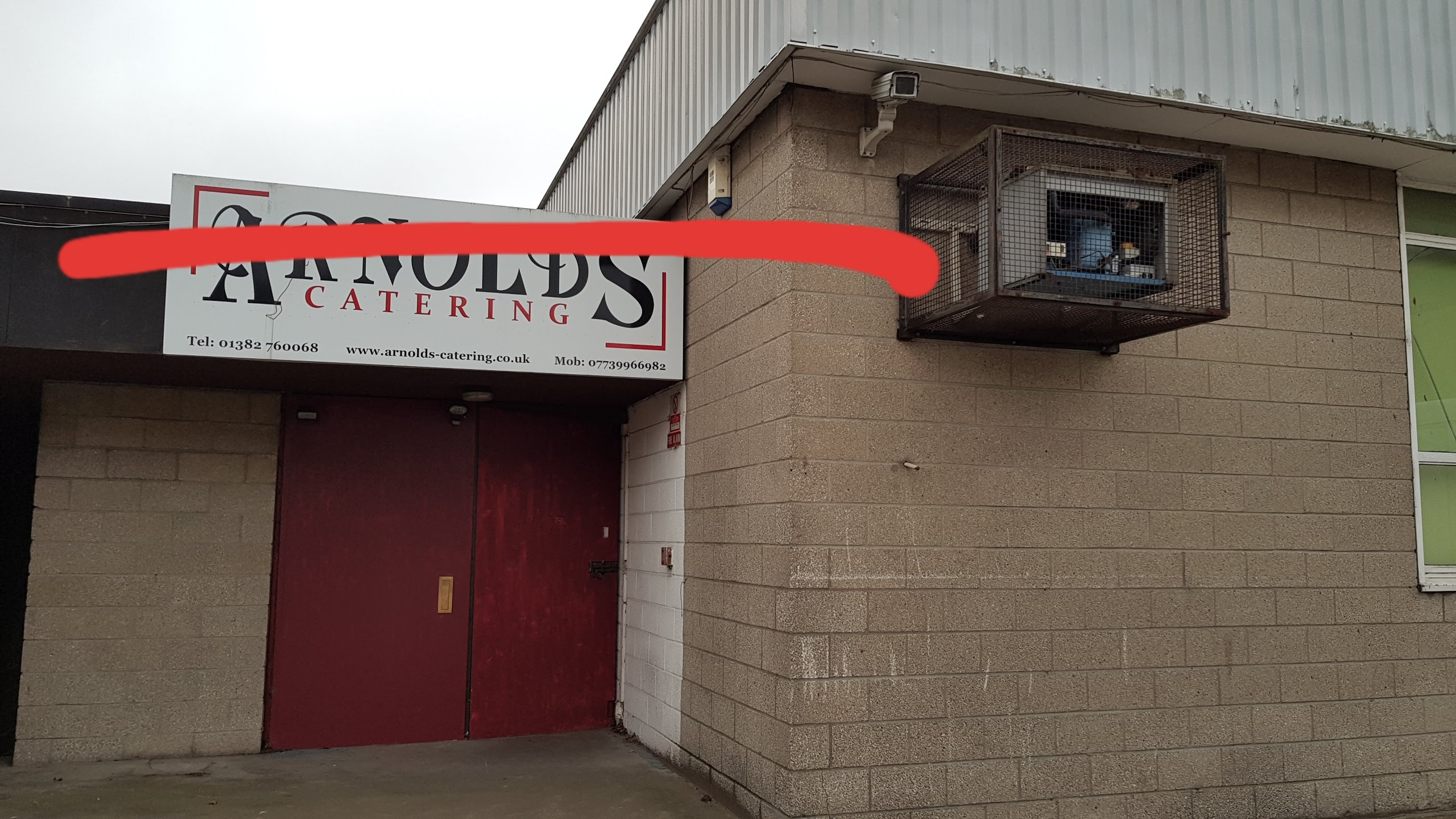 """A sign for the previous business owners """"Arnolds"""", crossed through with a red pen."""
