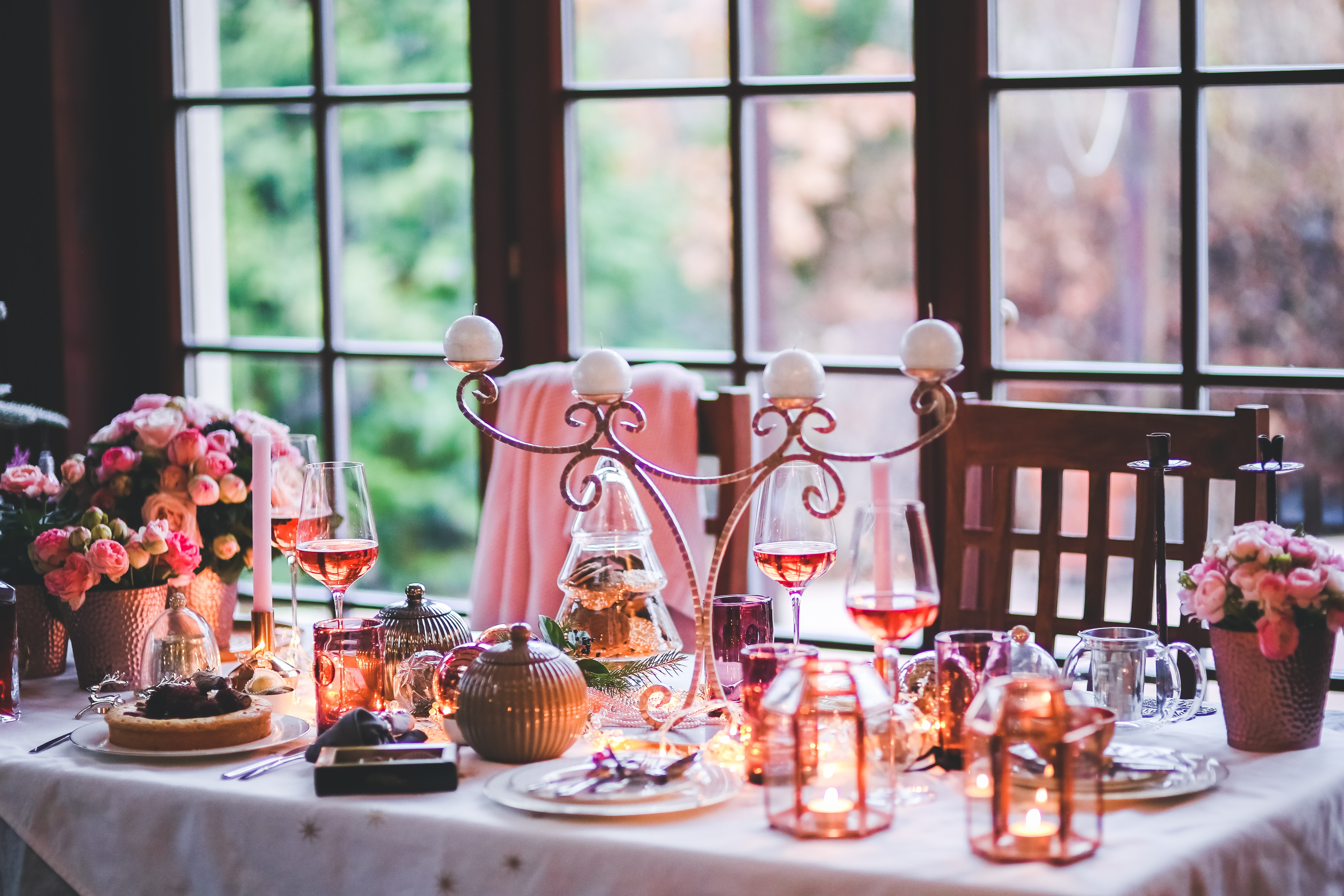 A pink and gold themed afternoon tea table.