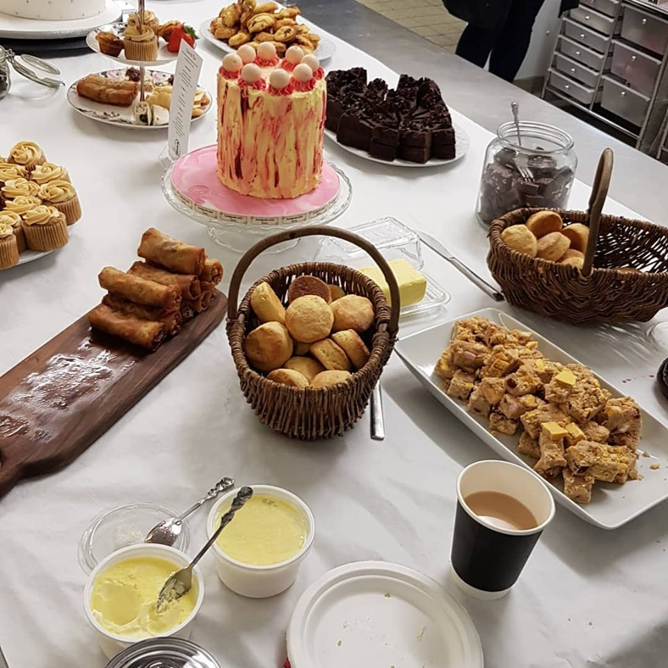A full afternoon tea spread by For Cakes Sake, including fajita rolls, buttermilk scones and our caramel apple cupcakes.
